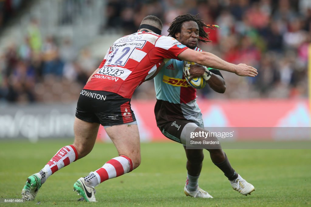 Marland Yarde of Harlequins is tackled by Andy Symons of Gloucester Rugby during the Aviva Premiership match between Harlequins and Gloucester Rugby at Twickenham Stoop on September 9, 2017 in London, England.