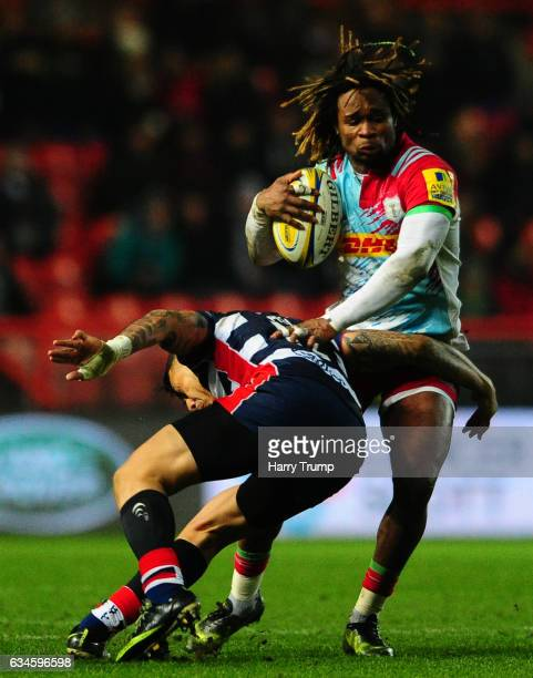 Marland Yarde of Harlequins is tackled by Billy Searle of Bristol Rugby during the Aviva Premiership match between Bristol Rugby and Harlequins at...