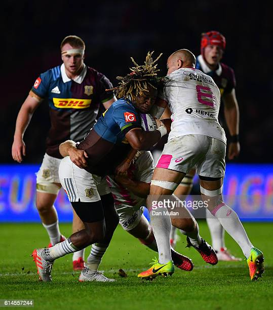 Marland Yarde of Harlequins is tackled by Craig Burden of Stade Francais and Sergio Parisse of Stade Francais during the European Rugby Challenge Cup...