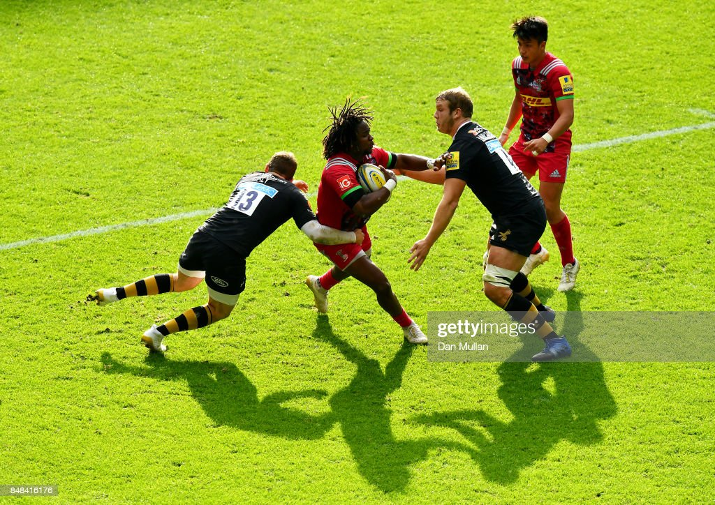 Marland Yarde of Harlequins is tackled by Elliot Daly and Joe Launchbury of Wasps during the Aviva Premiership match between Wasps and Harlequins at The Ricoh Arena on September 17, 2017 in Coventry, England.