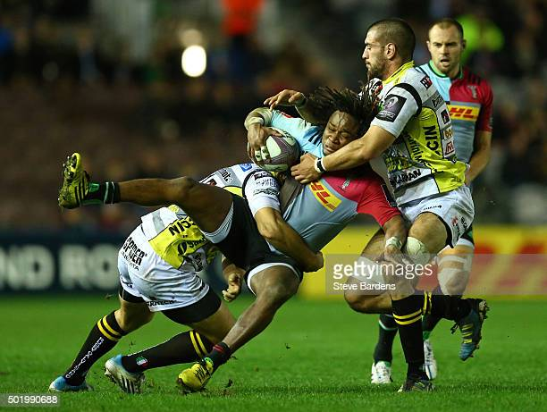 Marland Yarde of Harlequins is tackled by Marco Susio of Rugby Calvisano during the European Rugby Challenge Cup pool 3 match between Harlequins and...