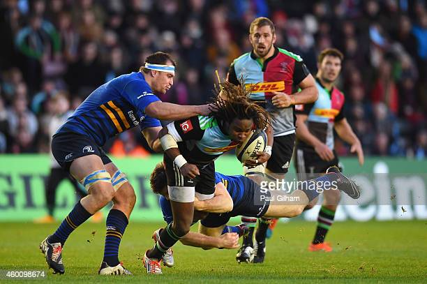 Marland Yarde of Harlequins is tackled by Rhys Ruddock of Leinster during the European Rugby Champions Cup Pool 2 match between Harlequins and...