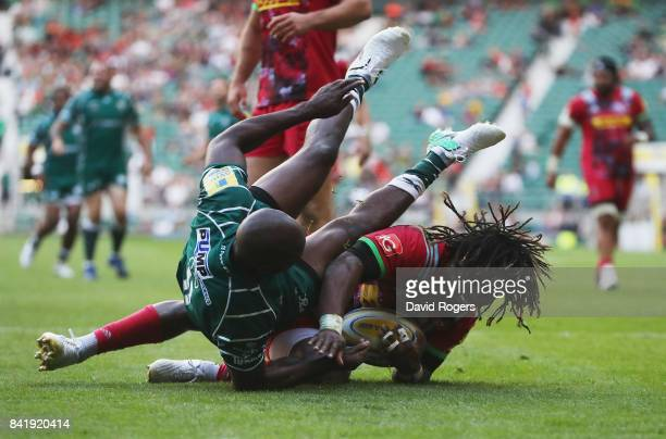 Marland Yarde of Harlequins is tackled by Topsy Ojo of London Irish during the Aviva Premiership match between London Irish and Harlequins at...