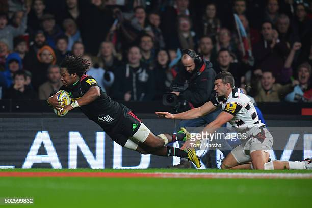 """Marland Yarde of Harlequins scores his teams opening try during the Aviva Premiership """"Big Game 8"""" match between Harlequins and Gloucester at..."""