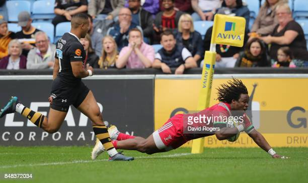Marland Yarde of Harlequins scores their first try during the Aviva Premiership match between Wasps and Harlequins at The Ricoh Arena on September 17...