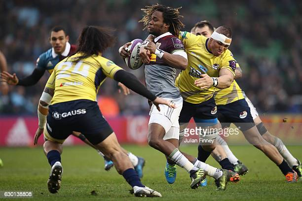 Marland Yarde of Quins is tackled around the neck by Randall Morrison of Saracens which ended in a red card during the European Rugby Challenge Cup...