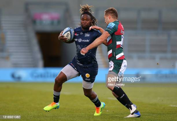 Marland Yarde of Sale holds off the challenge of Johnny McPhillips of Leicester during the Gallagher Premiership Rugby match between Sale and...