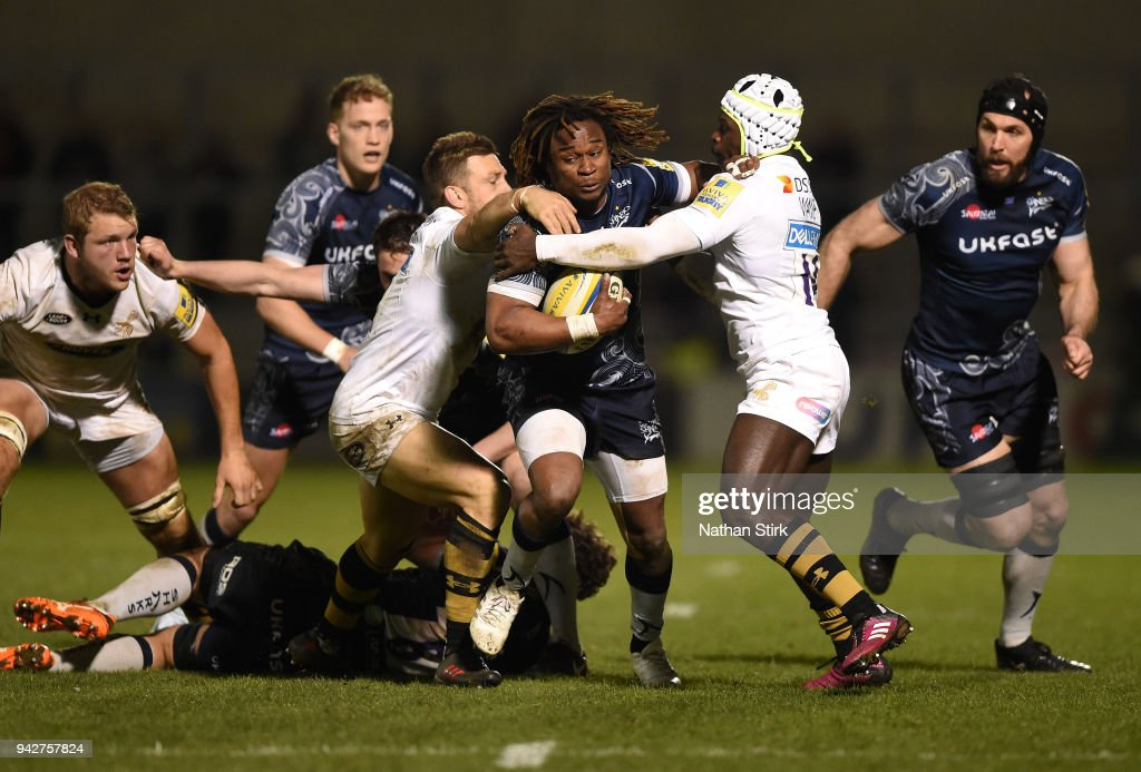 Marland Yarde of Sale is tackled by Christian Wade of Wasps during the Aviva Premiership match between Sale Sharks and Wasps at AJ Bell Stadium on April 6, 2018 in Salford, England.