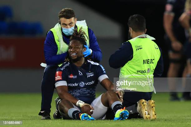 Marland Yarde of Sale receives treatment from the medics during the Gallagher Premiership Rugby match between Sale Sharks and Leicester Tigers at AJ...