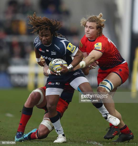 Marland Yarde of Sale Sharks breaks through the tackle of David Denton of Worcester Warriors during the Aviva Premiership match between Sale Sharks...