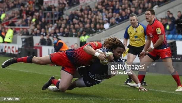 Marland Yarde of Sale Sharks holds off Bryce Heem of Worcester Warriors to score a try during the Aviva Premiership match between Sale Sharks and...