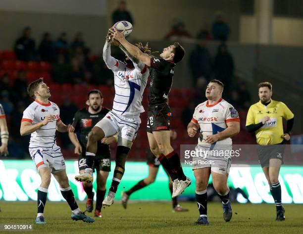 Marland Yarde of Sale Sharks jumps for the ball with Baptiste Couilloud of Lyon during the European Rugby Challenge Cup match between Sale Sharks and...
