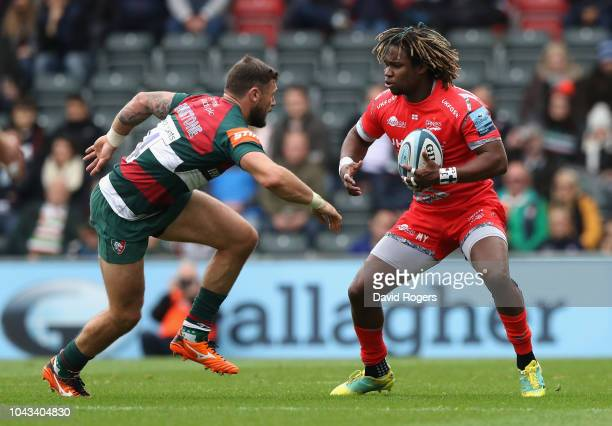 Marland Yarde of Sale Sharks takes on Adam Thompstone during the Gallagher Premiership Rugby match between Leicester Tigers and Sale Sharks at...