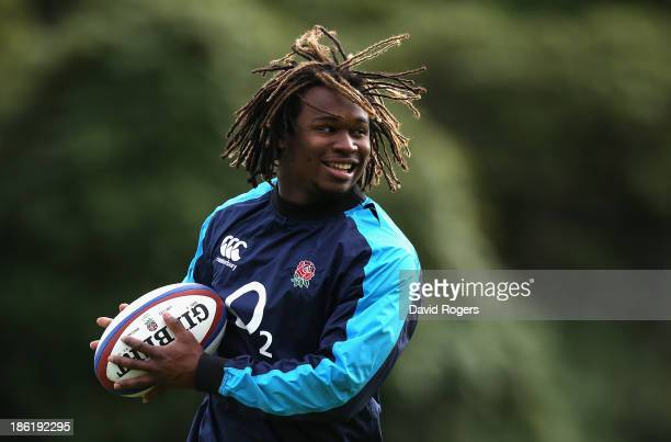 Marland Yarde runs with the ball during the England training session held at Pennyhill Park on October 29 2013 in Bagshot England