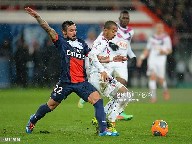 Marlano Ferreira Filho of Girondins de Bordeaux is challenged by Ezequiel Ivan Lavezzi of Paris Saint-Germain FC during the Ligue 1 match between...