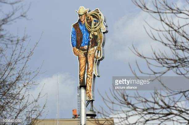 A Marlboro Man figure pictured on the rooftop of the cigarette manufacturer 'Philip Morris' in Berlin Germany 30 March 2016 PhotoSOERENSTACHE/dpa |...
