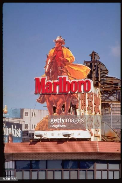 Marlboro man galloping on billboard