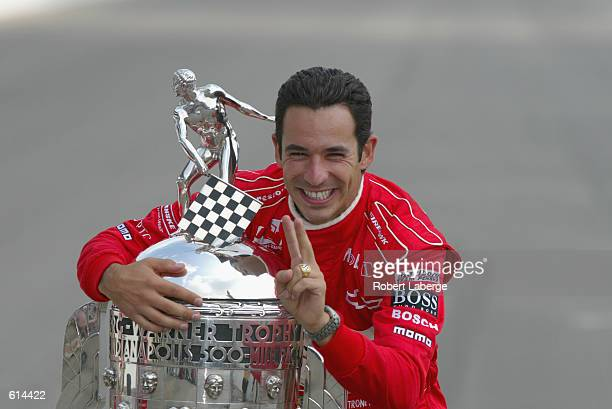 Marlboro Team Penske driver Helio Castroneves hugs the BorgWarner Trophy at the official trophy presentation on the day after winning the 86th...