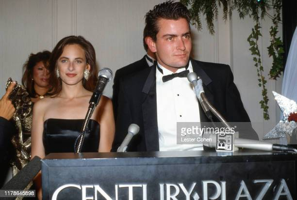 Marlee Matlin and Charlie Sheen attend For Love Of Children AIDS Benefit Gala on July 8 1988 at the Century Plaza Hotel in Century City California