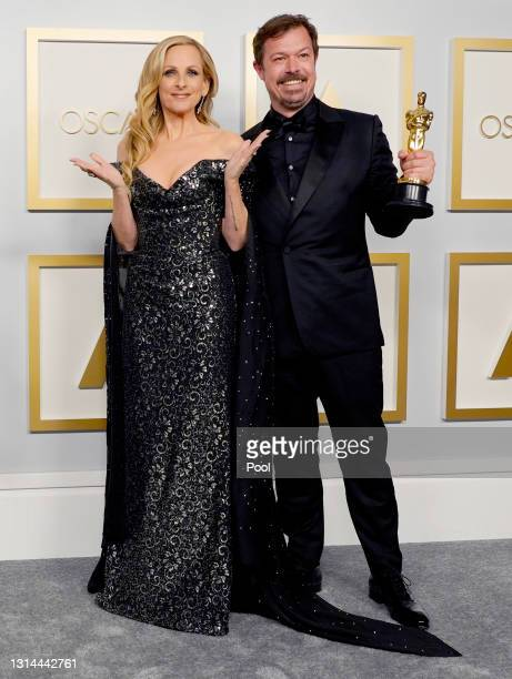 """Marlee Matlin poses with James Reed, winner of Best Documentary Feature for """"My Octopus Teacher"""", in the press room during the Oscars on Sunday,..."""