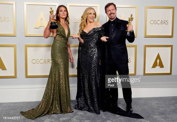 """Marlee Matlin poses with Pippa Ehrlich and James Reed , winners of Best Documentary Feature for """"My Octopus Teacher"""", in the press room during the..."""