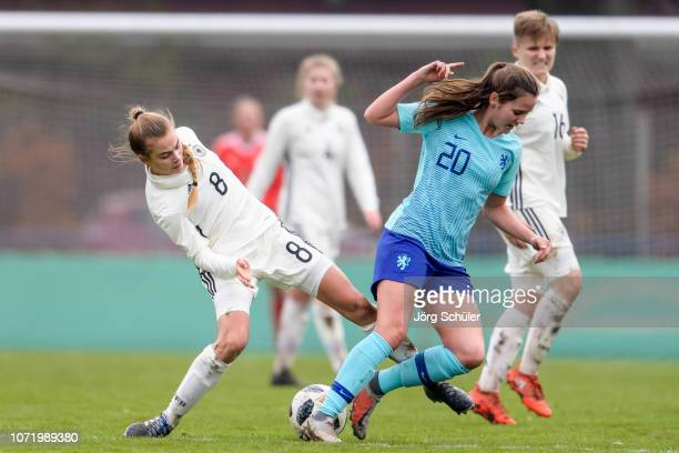 Marleen Rohde of Germany battles for the ball with Lotje de Keijzer of Netherlands during the U17 Girl's international friendly match between Germany...
