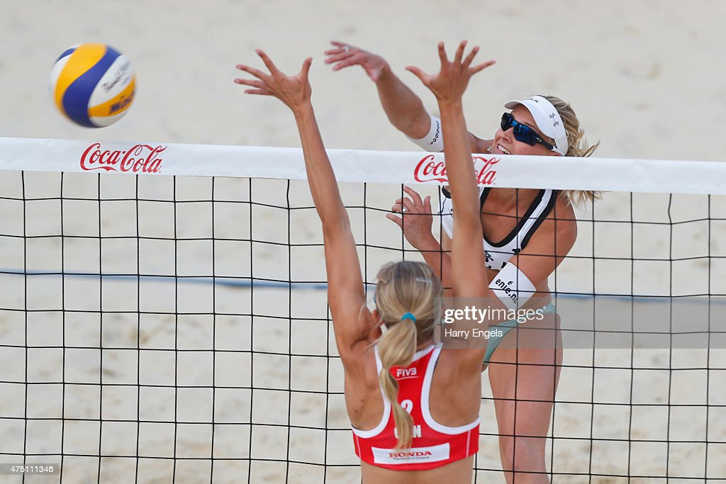 Marleen Van Iersel of the Netherlands smashes past Kristina Valjas of Canada during Day 2 of the FIVB Moscow Grand Slam on May 27, 2015 in Moscow, Russia.