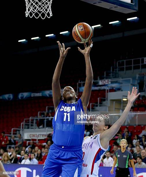 Marlen Cepeda of Cuba vies with her rival during 2014 FIBA World Championship For Women an elimination playoff match between Serbia and Cuba at Abdi...