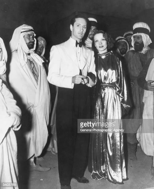 Marlene Dietrich and Basil Rathbone star in the David O Selznick film 'The Garden Of Allah' set in the Algerian desert