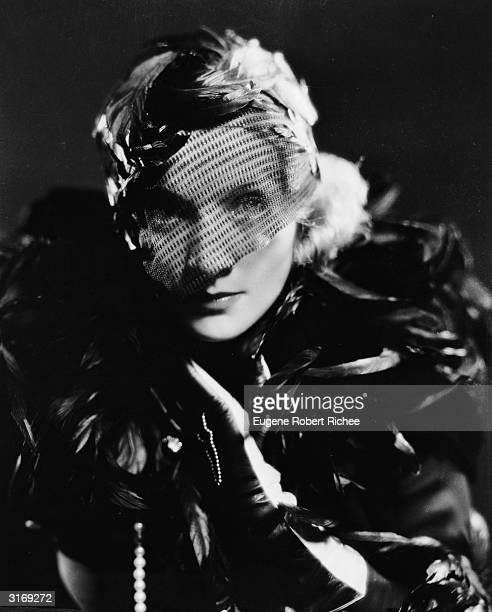 Marlene Dietrich as a befeathered Madeline or Shanghai Lily in the film 'Shanghai Express', directed by Josef von Sternberg. Costumes by Travis...