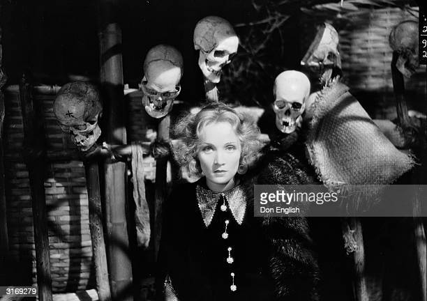 Marlene Dietrich as Madeline or Shanghai Lily gets the feeling she's not alone in a scene from the film 'Shanghai Express', directed by Josef von...