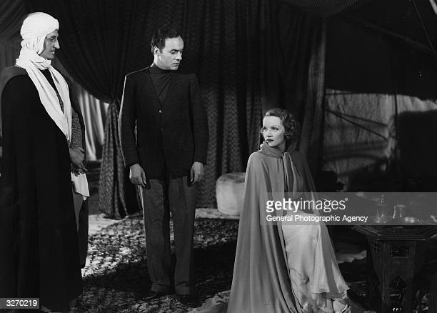 Marlene Dietrich Basil Rathbone and Charles Boyer star in the David O Selznick film 'The Garden Of Allah' an oldfashioned star vehicle directed by...
