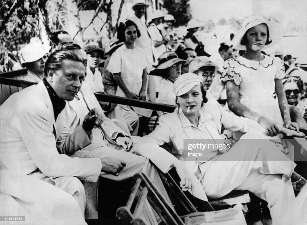 Marlene Dietrich, her daughter Maria and her husband Rudolf Sieber watching a Polo game. Los Angeles. Photograph. About 1935. : News Photo