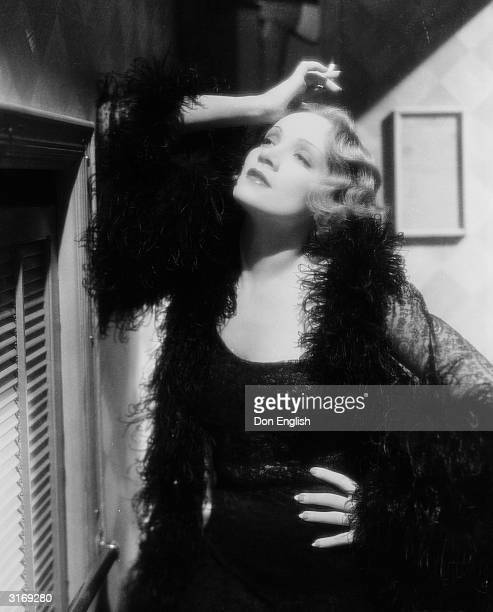 Marlene Dietrich in a seductive pose as Madeline or Shanghai Lily in the film 'Shanghai Express', directed by Josef von Sternberg. Costumes by Travis...