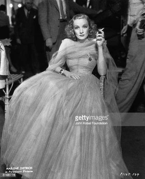 Marlene Dietrich in her role as Maria Barker in a scene from the romantic drama 'Angel' directed by Ernst Lubitsch for Paramount Costume designs by...
