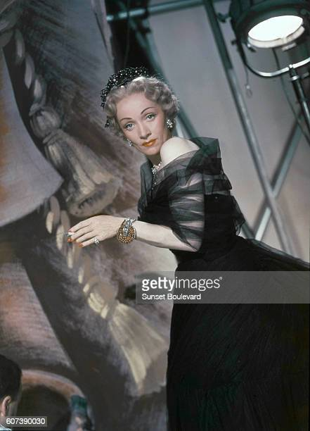 """Marlene Dietrich on the set of """"Stage Fright"""", directed by Alfred Hitchcok."""