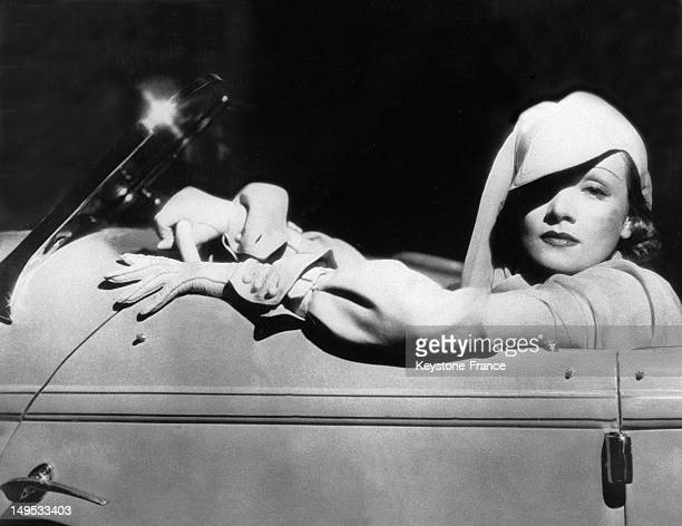 Marlene Dietrich poses in a sport outfit and a 1900 hat the actress designed her own clothes and was inspired by the fashion of the early 20th...