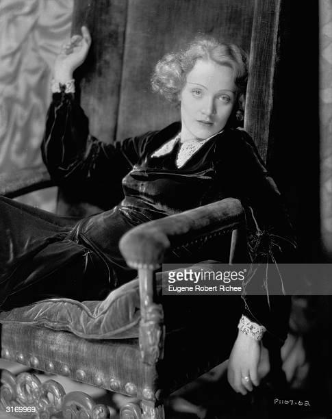 Marlene Dietrich slumped into a velvet chair.