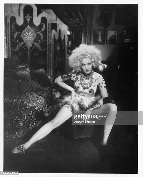 Marlene Dietrich stretches her leg in a scene from the film 'Blonde Venus' 1932