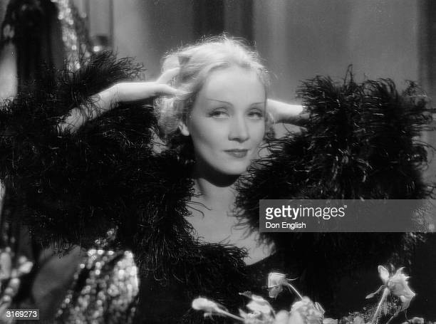 Marlene Dietrich strikes a pose as Madeline or Shanghai Lily in the film 'Shanghai Express' directed by Josef von Sternberg Costumes by Travis Banton