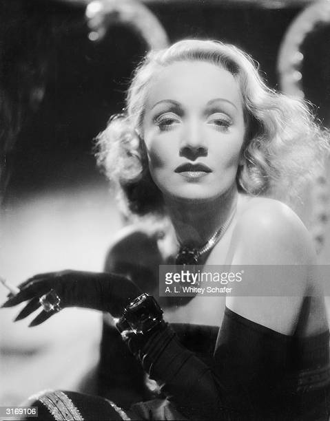 Marlene Dietrich wearing a matching set of ostentatious jewellery in the role of Elizabeth Madden in the comedy, 'The Lady is Willing', directed by...