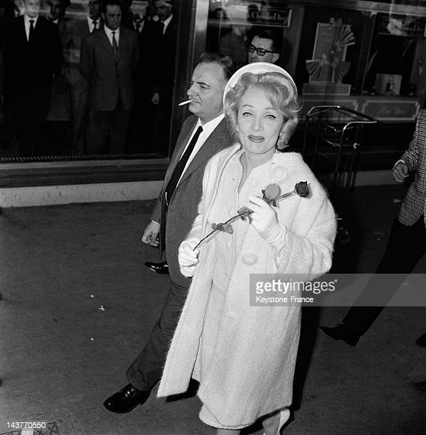 Marlene Dietrich welcomed by Olympia director Bruno Coquatrix at Paris Orly Airport before her concert on April 20 1962 in ParisFrance