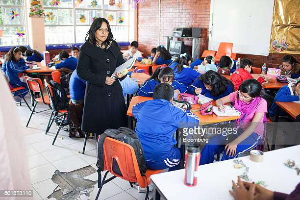Marlene Guerra principal of the Ingeniero Miguel Bernard primary school stands for a photograph in a classroom at the school on the southern...