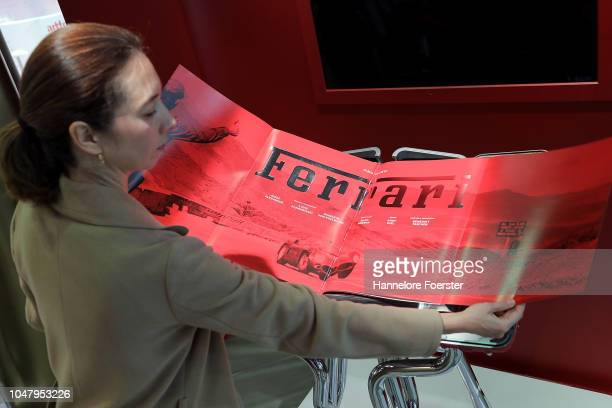 Marlene Taschen presents a special edition book about Ferrari worth 25000,00 Euro, at an exhibitor's stand prior to the opening of the Frankfurt Book...