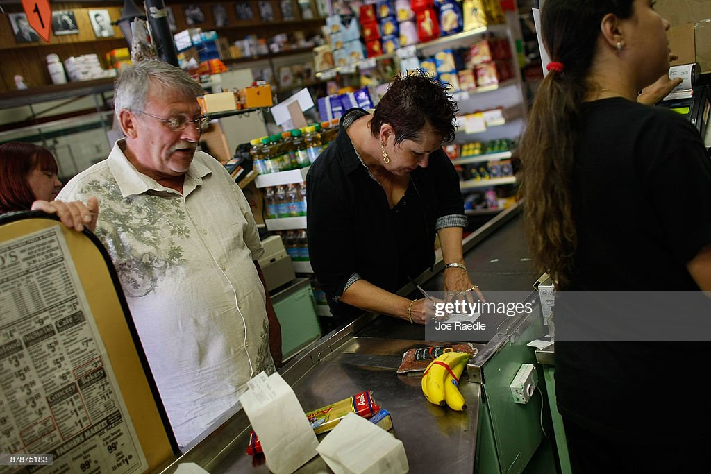 Marlene Woofter signs her credit card receipt as cashier Yera Dominguez charges the credit card for items at Lorenzo's Italian Market on May 20, 2009 in Miami, Florida. Larry Woofter stands to the left. Members of Congress today passed a bill placing new restrictions on companies that issues credit. The vote follows the Senate passage of the bill, which now heads for President Obama's promised signature. The bill will curb sudden interest rate increases and hidden fees, requiring card companies to tell customers of rate increases 45 days in advance. It will also make it harder for people aged below 21 to be issued credit cards.