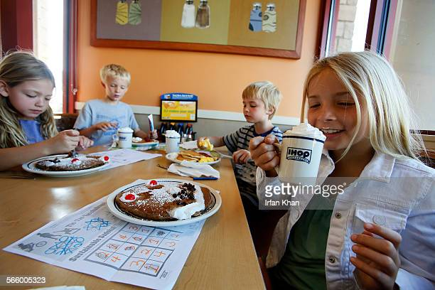 Marley Abowitz right with her siblings 7yearold Brody Aidan and Ruby sips on a drink at IHOP restaurant in Los Angeles