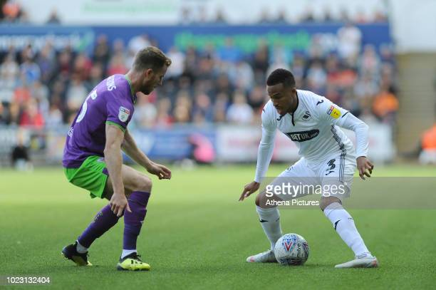 Marley Watkins of Bristol City vies for possession with Martin Olsson of Swansea City during the Sky Bet Championship match between Swansea City and...