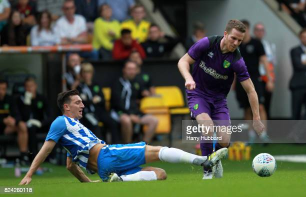 Marley Watkins of Norwich and Lewis Dunk of Brighton in action during the preseason friendly match between Norwich City and Brighton Hove Albion at...