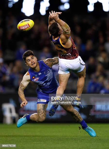 Marley Williams of the Kangaroos and Dayne Zorko of the Lions compete for the ball during the 2018 AFL round 11 match between the North Melbourne...