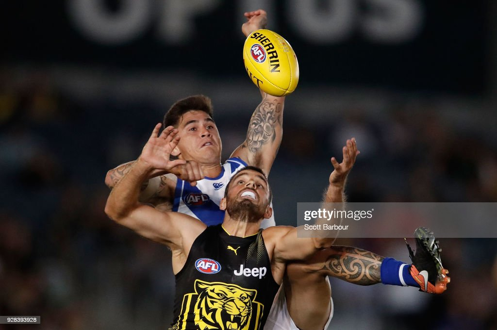 Marley Williams of the Kangaroos and Sam Lloyd of the Tigers compete for the ball during the AFL JLT Community Series match between the Richmond Tigers and the North Melbourne Kangaroos at Ikon Park on March 7, 2018 in Melbourne, Australia.